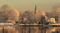 Village harbor in new snowfall Stock Footage