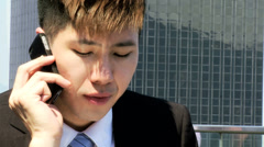 Close Up Smart Young Male Ethnic Share Broker Outdoors Talking Smart Phone Stock Footage