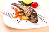 Stock Photo of fried trout with vegetables and split almonds