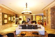 Stock Photo of the large chandelier at lobby in luxury hotel in night illumination, peloponn