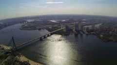 Several bridges across the river on a background of city aerial view. Stock Footage