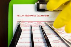Health Insurance Claim Form. - stock photo