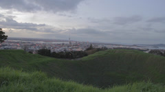 Wide aerial dolly shot of Auckland CBD from 2nd highest point, Mount Eden Stock Footage