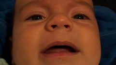 Face of puling baby close up Stock Footage