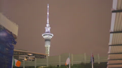 Auckland waterfront nightlife skytower to local bar - stock footage