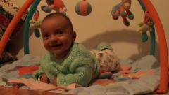 Happy baby on playmat 2 Stock Footage