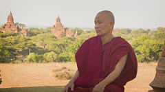 Buddhist monk in old ancient temple Stock Footage
