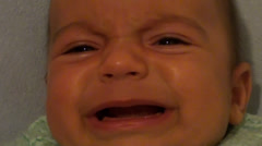 Weeping baby face close up mute - stock footage