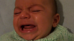 Weeping child face close up Stock Footage