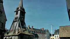 Europe France Normandy fishing village of Honfleur 034 roofs and church tower Stock Footage