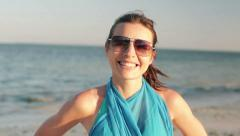 Portrait of happy young woman standing on exotic beach HD Stock Footage