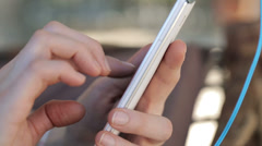 Woman hands using, texting on smartphone outdoors HD - stock footage