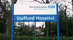 Stafford hospital sign outside Stafford hospital, Stafford, Staffordshire HD Stock Footage