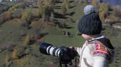 Little  amateur photographer with camera and tripod on gorgeous nature landscape Stock Footage