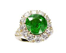 Beautiful ring with green gem isolated on white Stock Photos