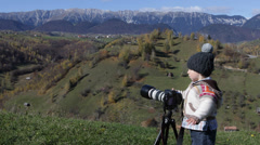 Sweet little photographer try to make settings, beautiful rural scenery Stock Footage
