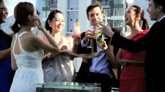 Happy Young Asian Western Friends Celebrating Rooftop Bar Stock Footage