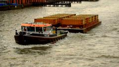 Tug Boat pulling barge on Thames River Stock Footage