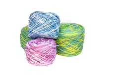 Four rolls of multi-colored crochet cotton Stock Photos