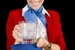 Flight attendant serving a drink Stock Photos