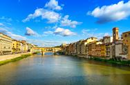 Stock Photo of ponte vecchio landmark on sunset, old bridge, arno river in florence. tuscany