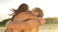 SLOW MOTION: Happy young couple hugging at sunset Stock Footage