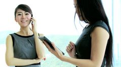 Young Ethnic Businesswomen Wireless Smart Phone Mini Tablet Stock Footage