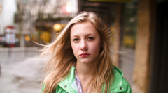 Closeup  Of Serious Teen Girl On A City Sidewalk Stock Footage