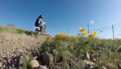 MOTORCYCLE MOTOCROSS MOTORBIKE IN SLOW MOTION WHEELIE IN FLOWERS HD - stock footage