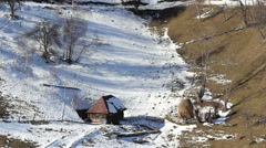 Lonely wooden house on snowed mountain valley Stock Footage