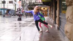 Teen Girls Make Up Silly Dances With Their Umbrellas While They Wait For A Train Stock Footage