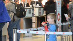 Child waiting to board flight at airport Stock Footage