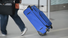 Blue Rolling Suitcase At Airport Stock Footage