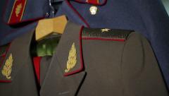 Soviet Uniforms - tilt up on officer's uniforms Stock Footage