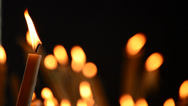 Stock Video Footage of Candle with candles defocused