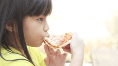 Girl enjoyed with pizza - stock footage