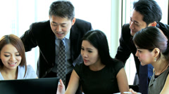 Asian Chinese Business Focus Group Future Planning Laptop Stock Footage