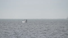 Small fishing boat on vast ocean. Stock Footage