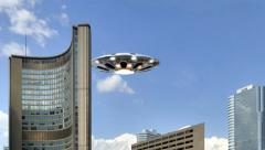 Ufo flying over skyscraper Stock Footage