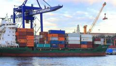 Cargo ship with containers stacked tidy row upon row Stock Footage