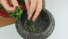 Herbs In Mortar Then Pestle Crushing - stock footage