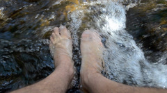 washing feet in water - stock footage