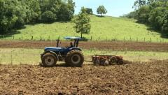 Plantation with farm tractor Stock Footage
