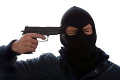 Criminal commiting suicide Stock Photos