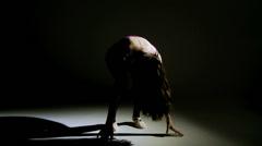 Professional teenager dancer in the dark Stock Footage