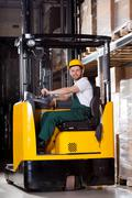 Stock Photo of smiling forklift driver