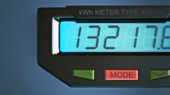 Digital electricity meter showing household consumption.power watt energy KWh - stock footage