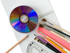 Stationery  on copy-book Stock Photos