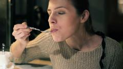 Beautiful woman eating tasty cake at cafe Stock Footage