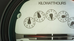 Analog electricity meter showing household consumption.power watt energy KWh - stock footage